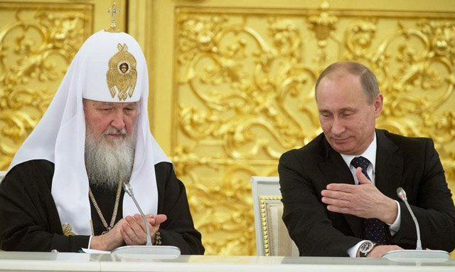 Russia's President Putin and Patriarch of Moscow and All Russia Kirill attend a meeting with Russian Orthodox church bishops in Moscow