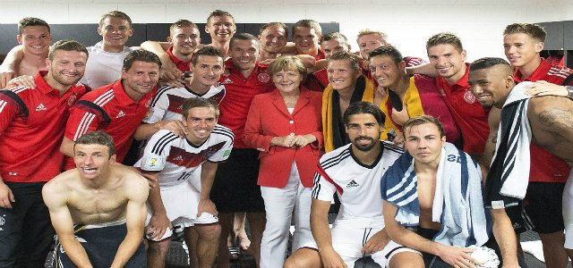 Can We just enjoy this picture of German Chancellor Angela Merkel in the changing room with the winning team